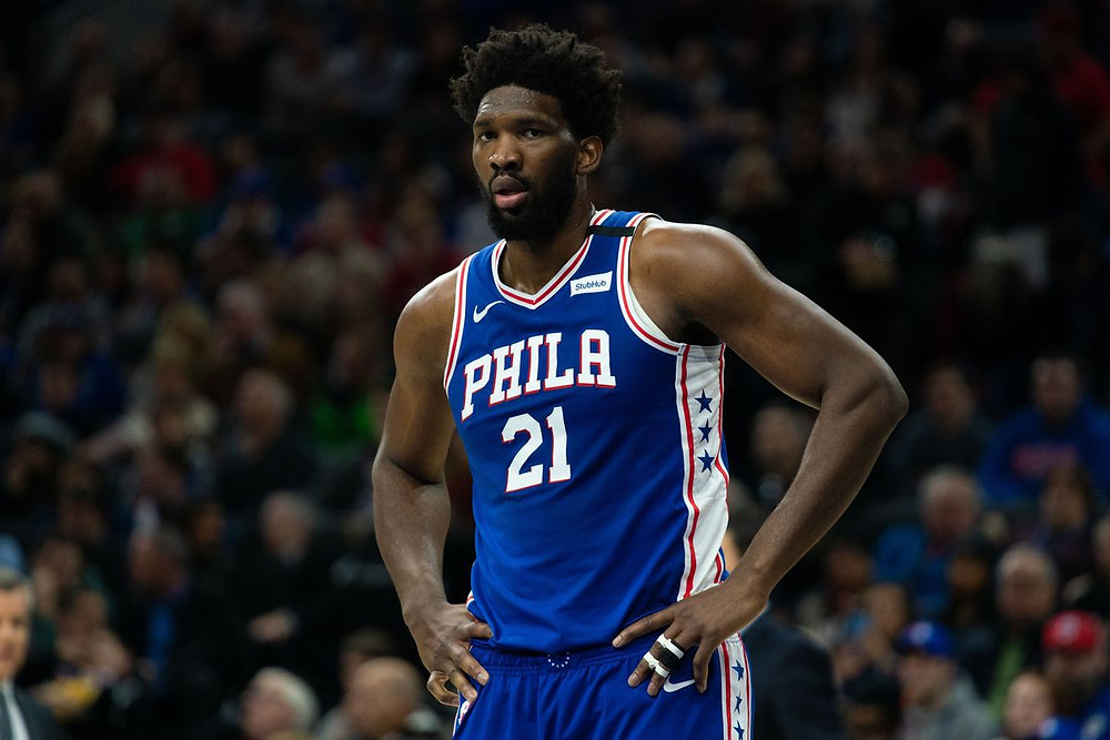 Philadelphia 76ers center Joel Embiid rests during a break in an NBA basketball game.