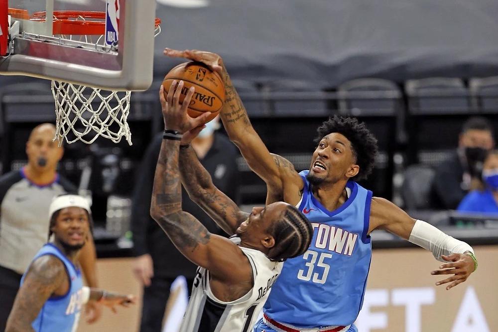 Houston Rockets center Christian Wood blocks San Antonio Spurs small forward DeMar DeRozan's layup attempt during an NBA basketball game.
