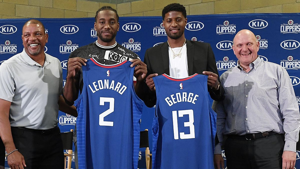 Head coach Doc Rivers and owner Steve Ballmer stand with Kawhi Leonard and Paul George  at their introductory press conference for the Los Angeles Clippers in July of 2019.