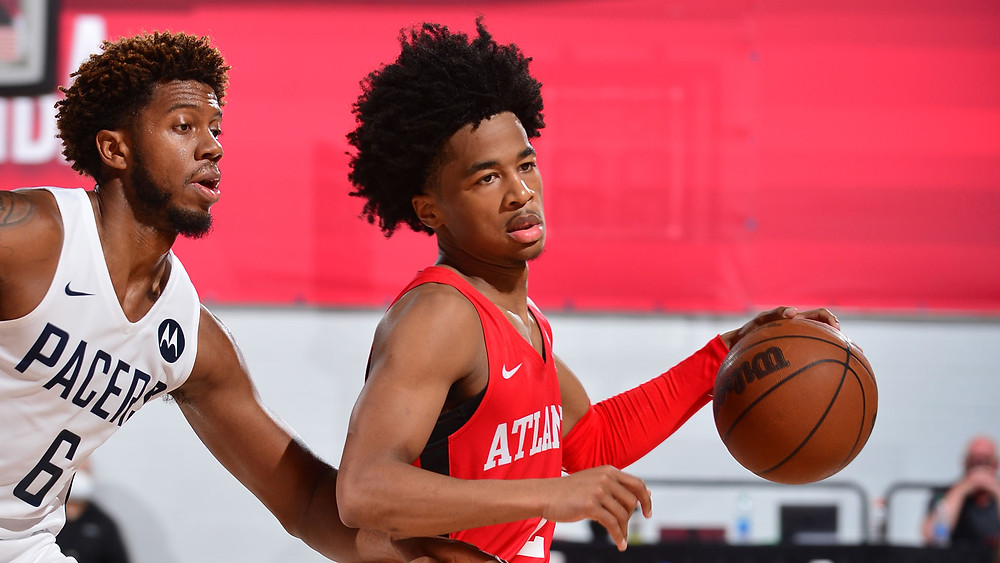 Atlanta Hawks point guard Sharife Cooper dribbles the basketball while being defended by Indiana Pacers guard Tyrone Wallace during an NBA Summer League game on August 10, 2021.
