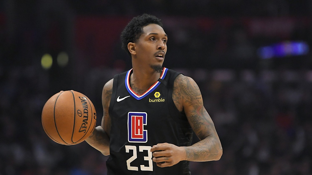 Los Angeles Clippers point guard Lou Williams dribbles the basketball up the court on offense during an NBA basketball game.