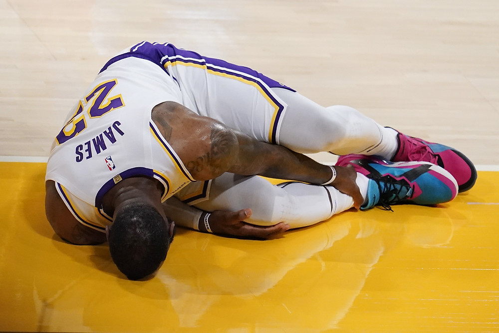 Los Angeles Lakers forward LeBron James clutches his right ankle in pain during an NBA basketball game against the Atlanta Hawks on March 20.