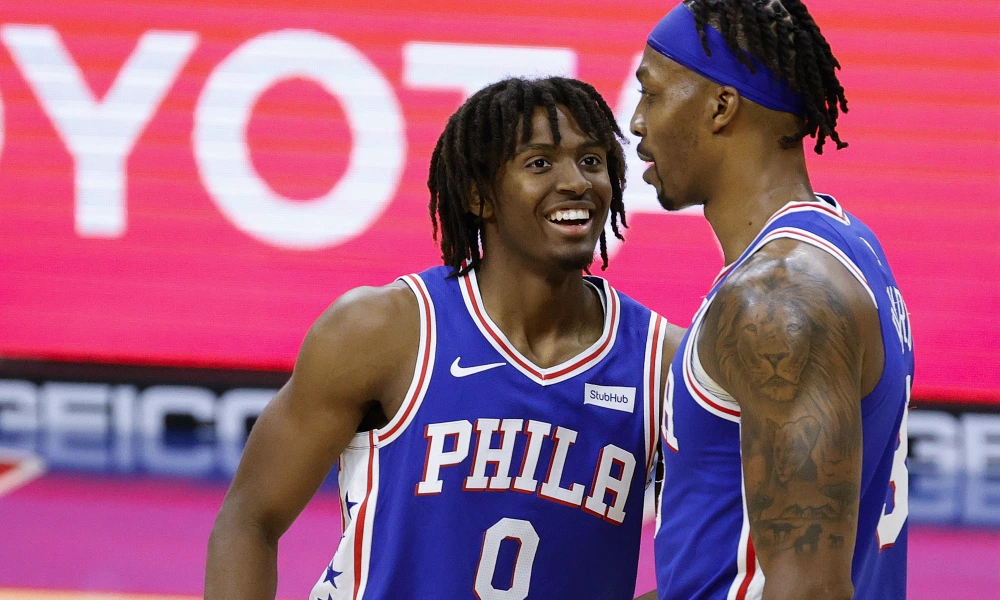 Philadelphia 76ers guard Tyrese Maxey and center Dwight Howard celebrate following a made basket during an NBA basketball game.