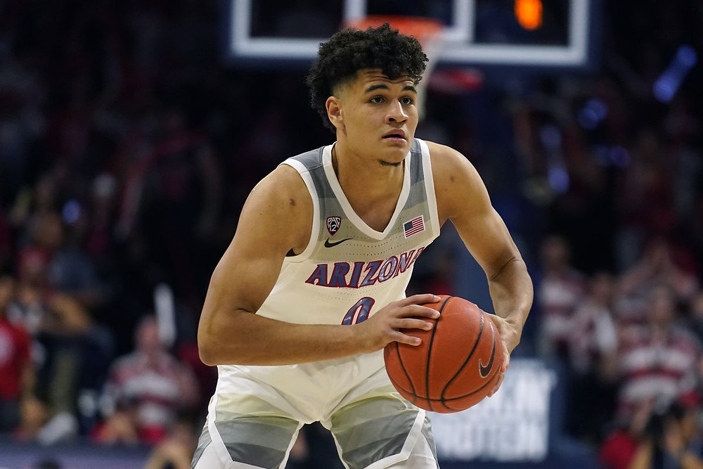 Arizona Wildcats forward Josh Green passes the ball at the top of the 3-point arc in an NCAA basketball game against Washington State on Thursday, March 5, 2020.