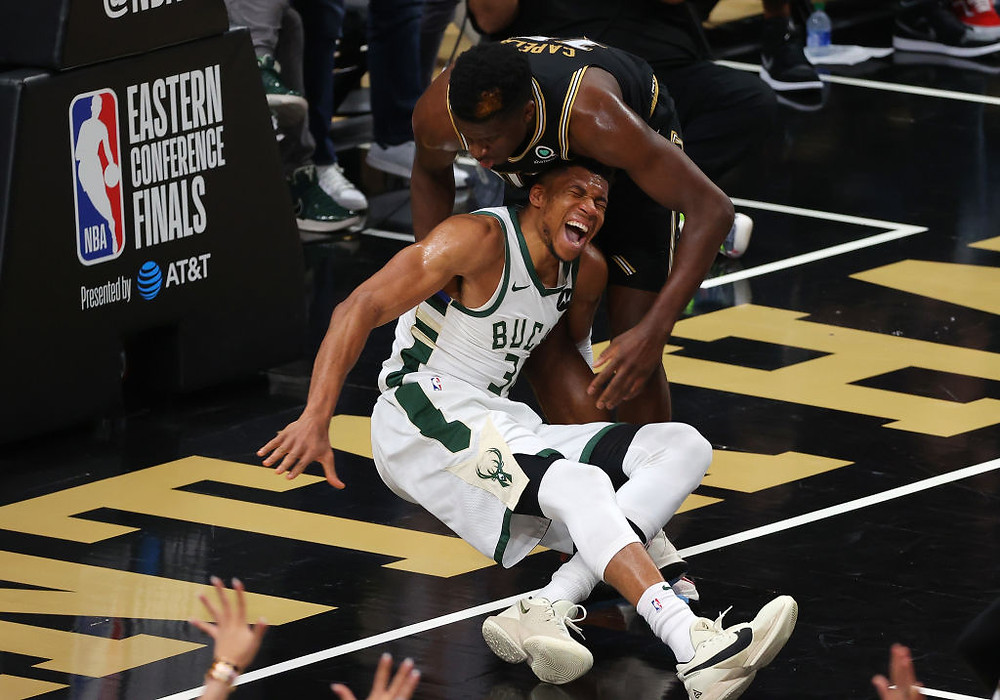Milwaukee Bucks forward Giannis Antetokounmpo screams in pain after suffering a hyperextended knee during Game 4 of the Eastern Conference Finals against the Atlanta Hawks.