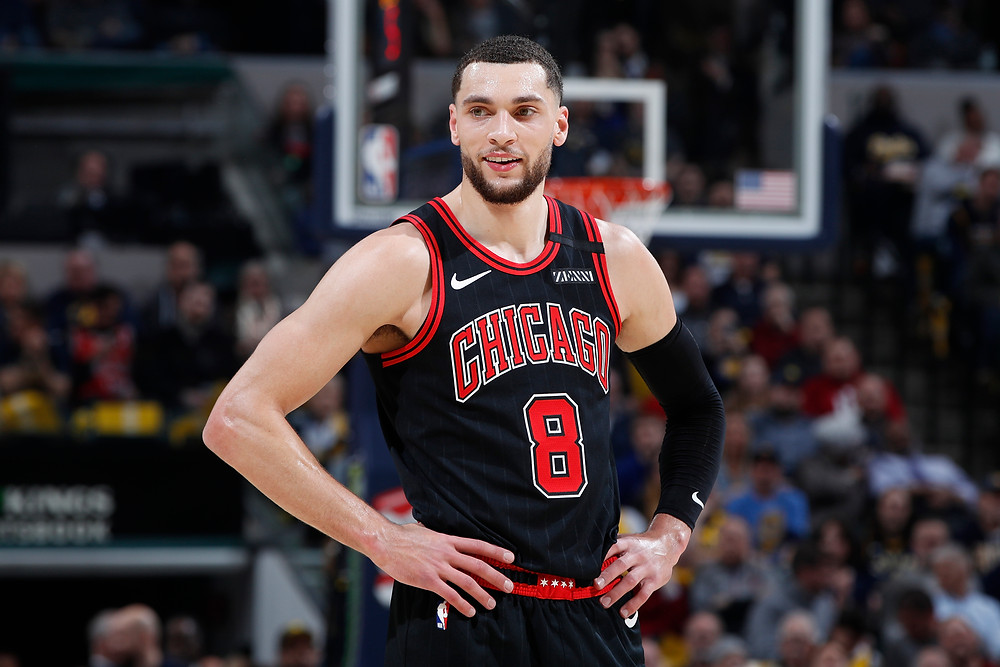 Chicago Bulls shooting guard Zach LaVine smiles as he rests his hands on his hips during an NBA basketball game.