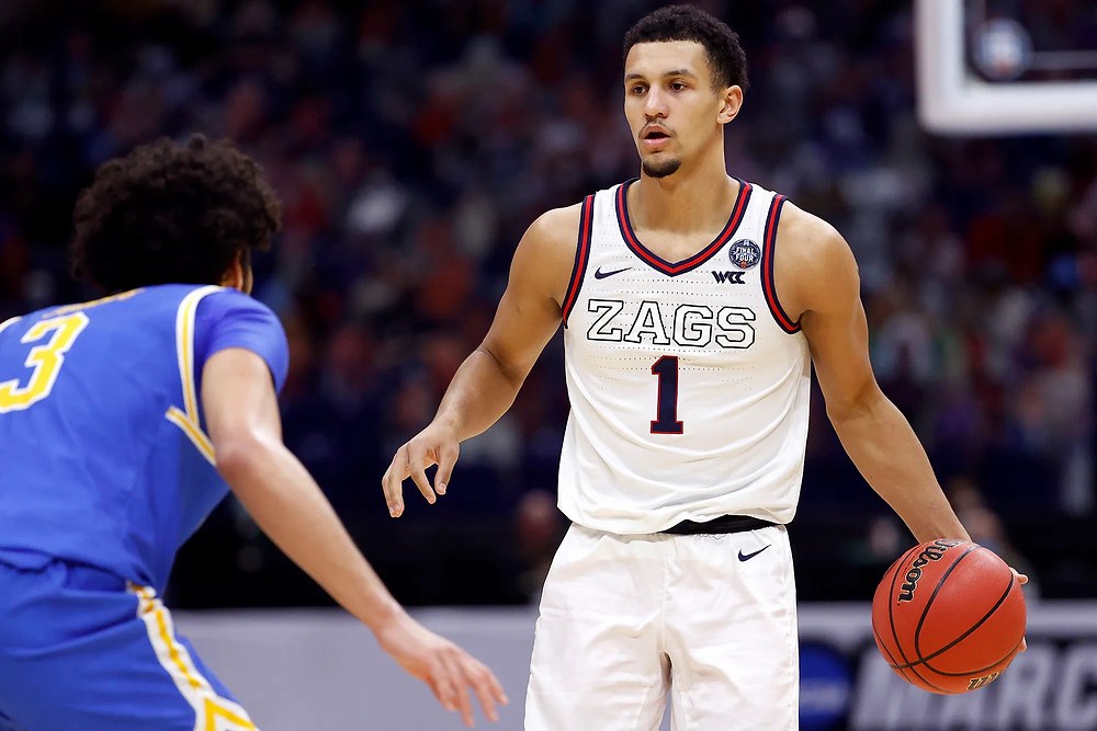 Gonzaga Bulldogs guard Jalen Suggs dribbles the basketball against UCLA's Johnny Juzang during the Final Four matchup of the NCAA March Madness tournament on April 3, 2021.