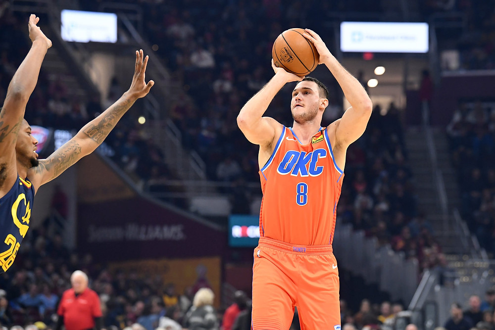 Oklahoma City Thunder small forward Danilo Gallinari shoots a 3-pointer over Alfonzo McKinnie of the Cleveland Cavaliers in an NBA basketball game.