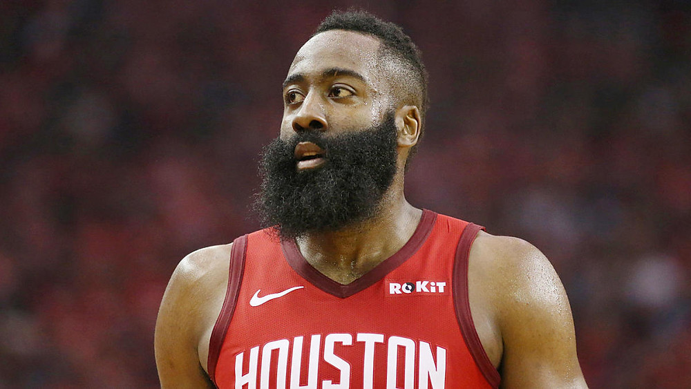 James Harden, formerly on the Houston Rockets, looks toward the basket during an NBA basketball game.