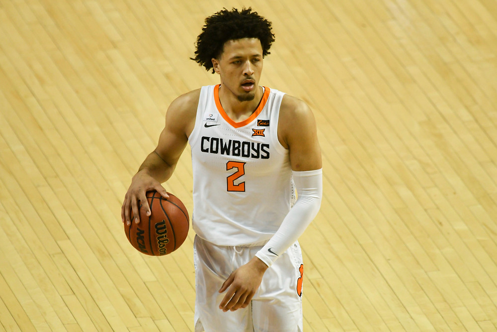 Oklahoma State Cowboys guard Cade Cunningham dribbles the basketball on offense during an NCAA basketball game.