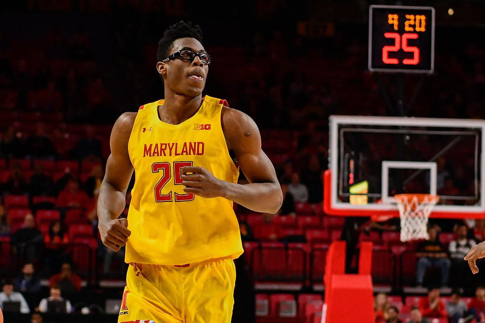 Maryland center Jalen Smith backpedals after scoring a basket in an NCAA basketball game.