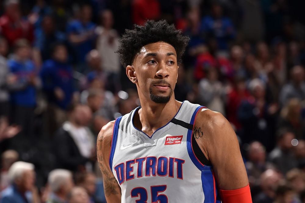 Detroit Pistons center Christian Wood looks at the court during an NBA basketball game.