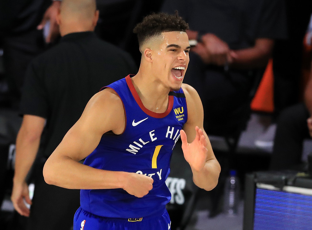 Denver Nuggets forward Michael Porter Jr. celebrates after a made basket in an NBA basketball game in the Orlando bubble.