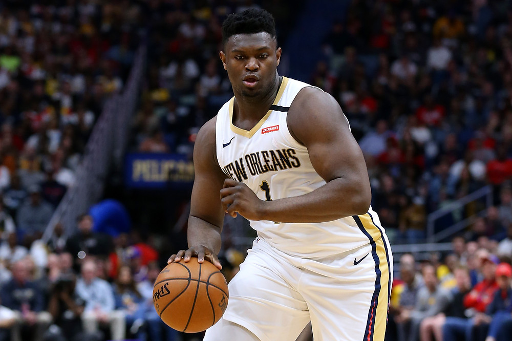 Zion Williamson of the New Orleans Pelicans dribbles the basketball up the court in an NBA game.