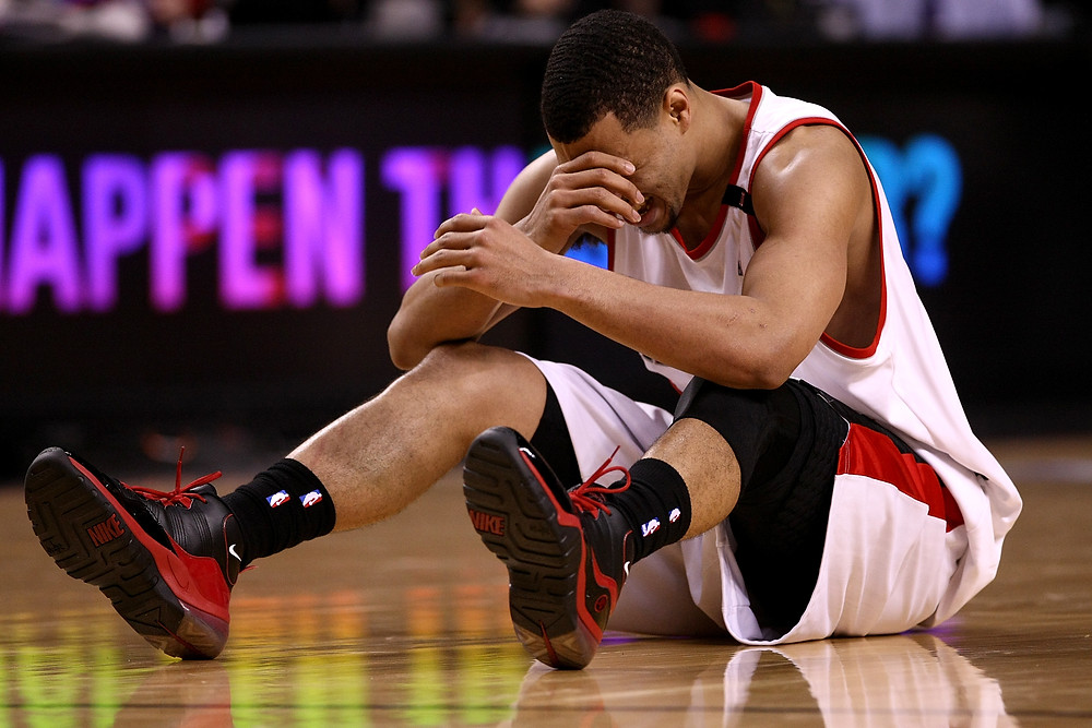 Portland Trail Blazers guard Brandon Roy is shaken by a knee injury during an NBA basketball game.