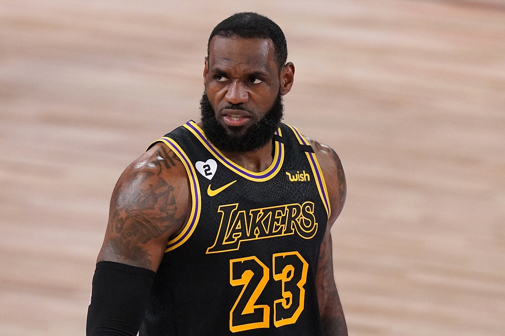 Los Angeles Lakers small forward LeBron James growls in celebration during an NBA basketball game.