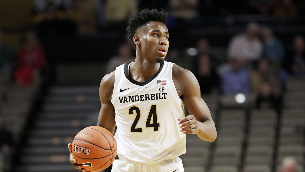 Small forward Aaron Nesmith dribbles the ball up the court for the Vanderbilt Commodores.