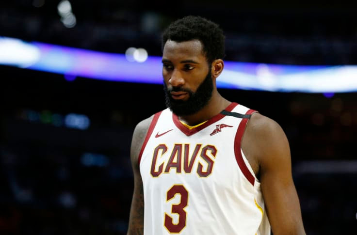 Cleveland Cavaliers center Andre Drummond looks toward the end of the court in an NBA basketball game.
