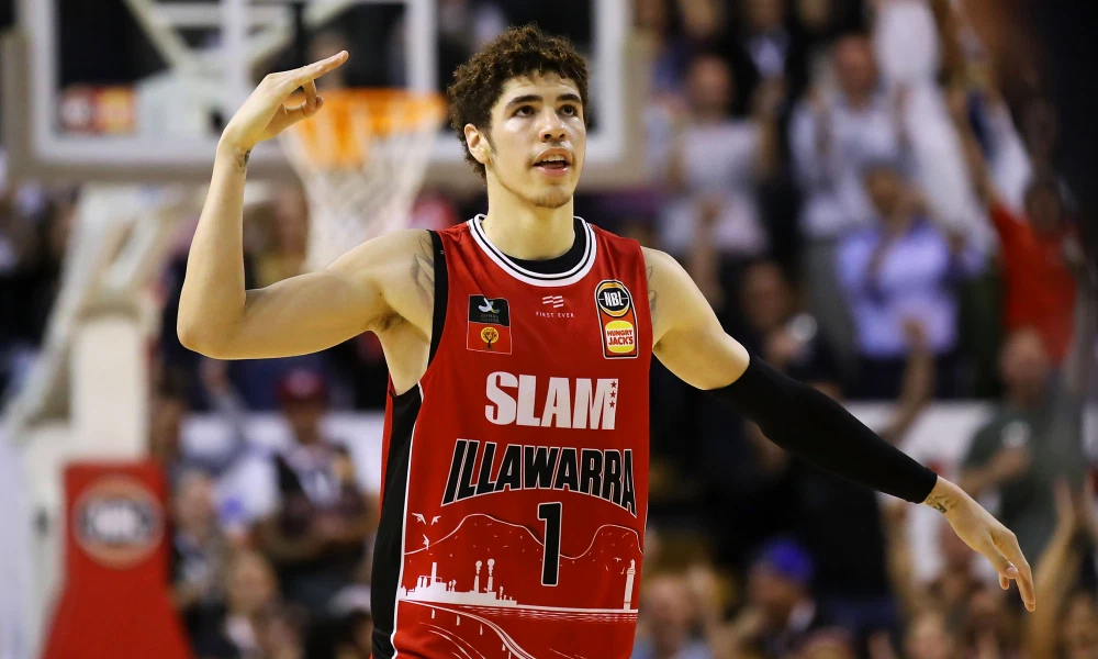 LaMelo Ball celebrates a made 3-point attempt during an NBL basketball game for the Illawarra Hawks.