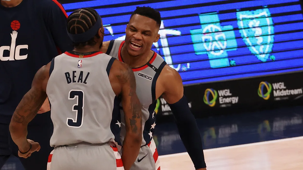 Washington Wizards guards Bradley Beal and Russell Westbrook celebrate following a made basket during an NBA basketball game.