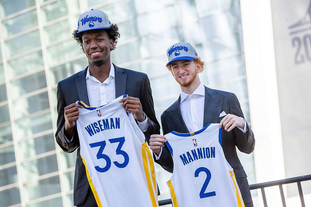 Golden States Warriors rookies James Wiseman and Nico Mannion hold up their new jerseys in an introductory press conference on Thursday, November 19, 2020.