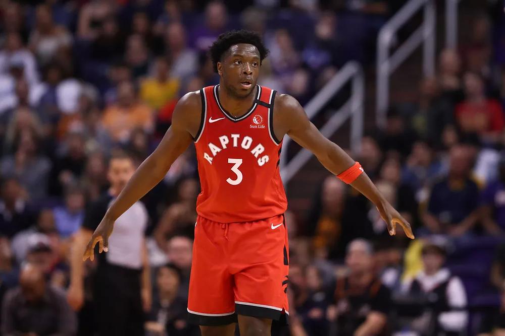 Toronto Raptors forward OG Anunoby reacts after a made basket during an NBA basketball game.