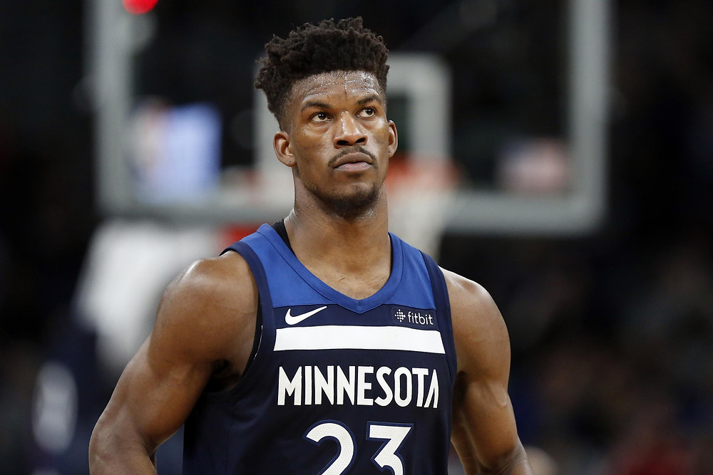 Minnesota Timberwolves shooting guard Jimmy Butler looks out in an NBA basketball game.