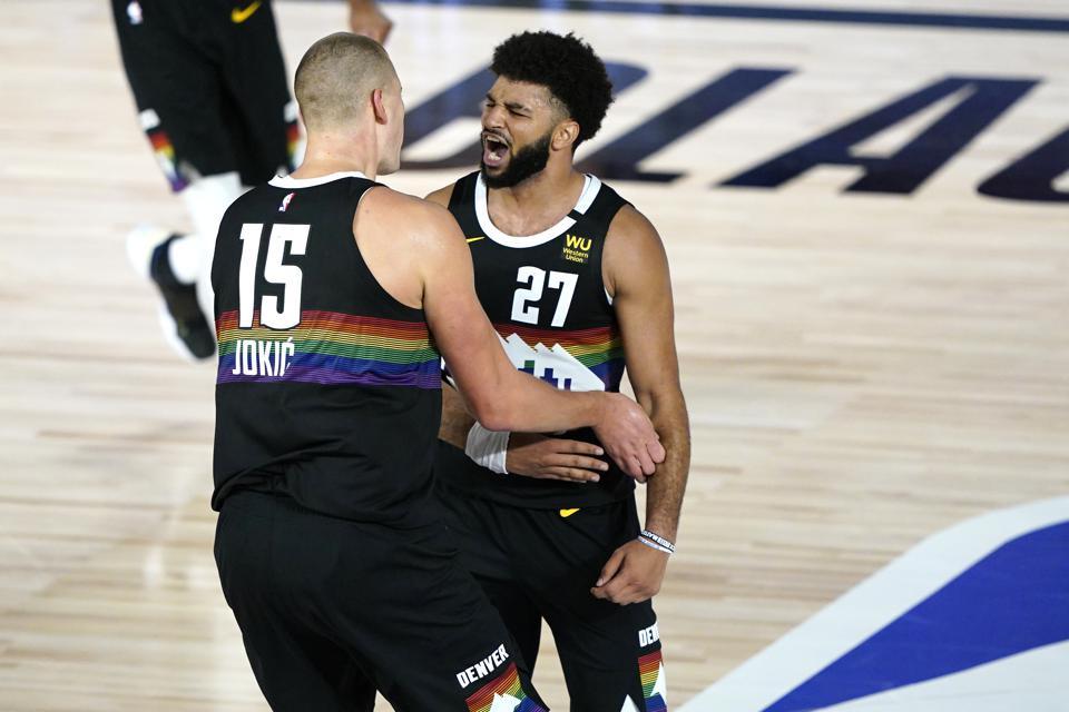 Jamal Murray and Nikola Jokić celebrate in the Orlando bubble.