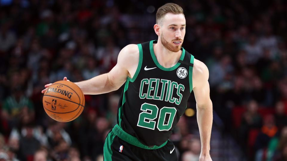 Boston Celtics small forward Gordon Hayward drives toward the basket in an NBA basketball game.