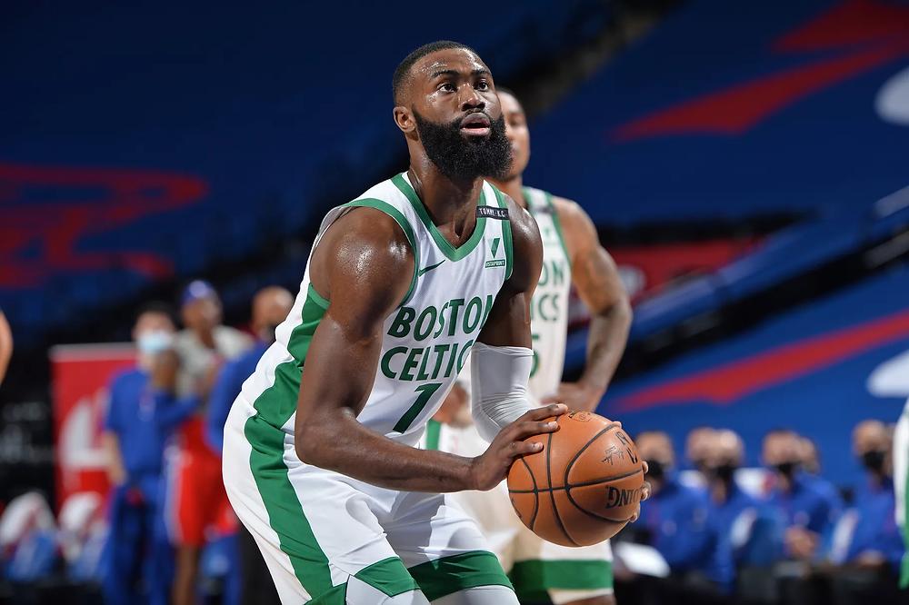 Boston Celtics shooting guard Jaylen Brown prepares to shoot a free throw during an NBA basketball game against the Philadelphia 76ers.