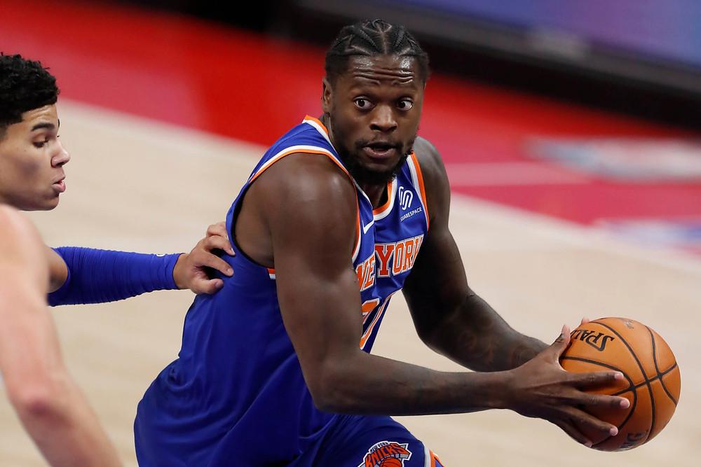 New York Knicks power forward Julius Randle prepares to drive against defender Killian Hayes during an NBA basketball against the Detroit Pistons.
