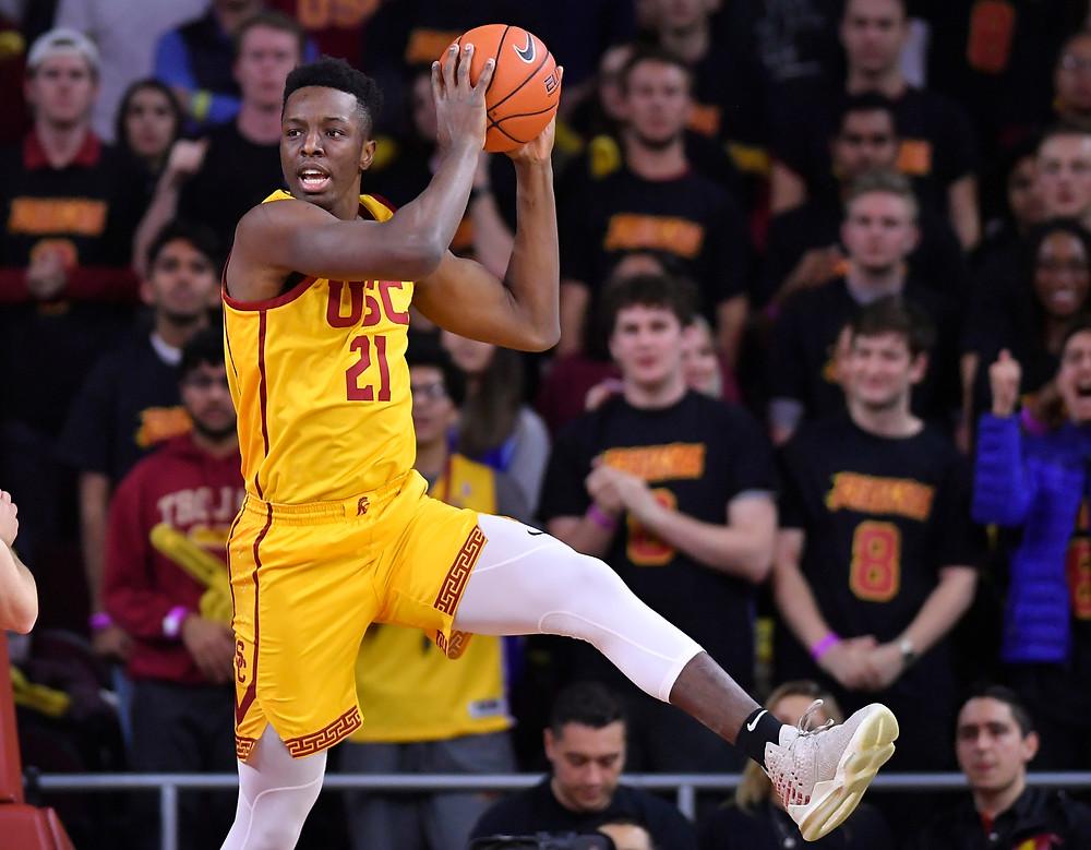 USC Trojans power/forward/center Onyeka Okongwu grabs a rebound during an NCAA basketball game.