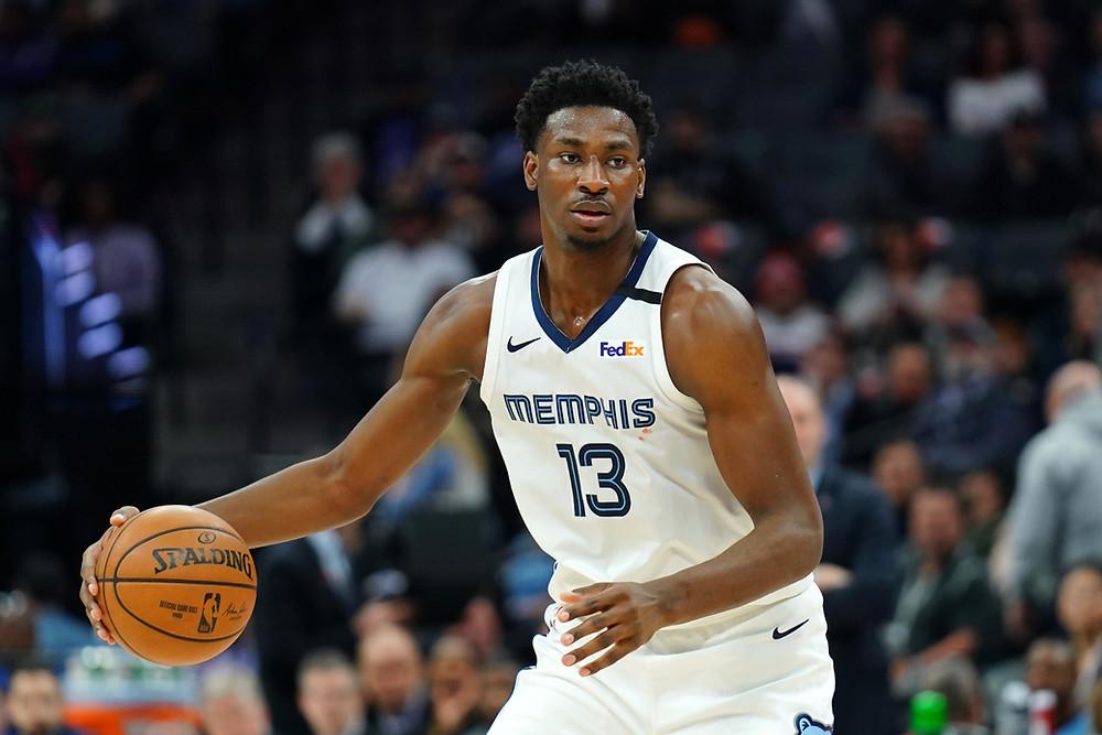 Memphis Grizzlies power forward Jaren Jackson Jr. dribbles the ball on offense during an NBA basketball game.
