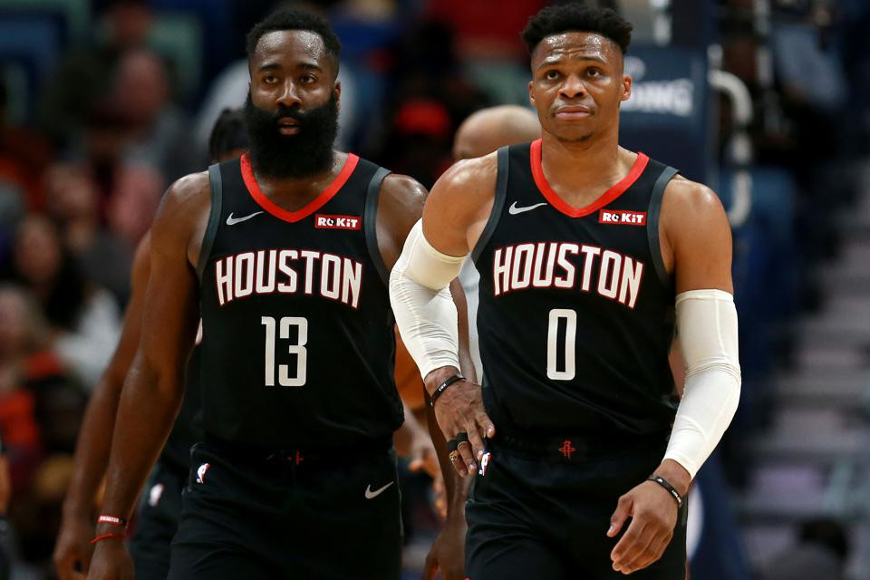 James Harden and Russell Westbrook of the Houston Rockets look towards the defense in an NBA game.