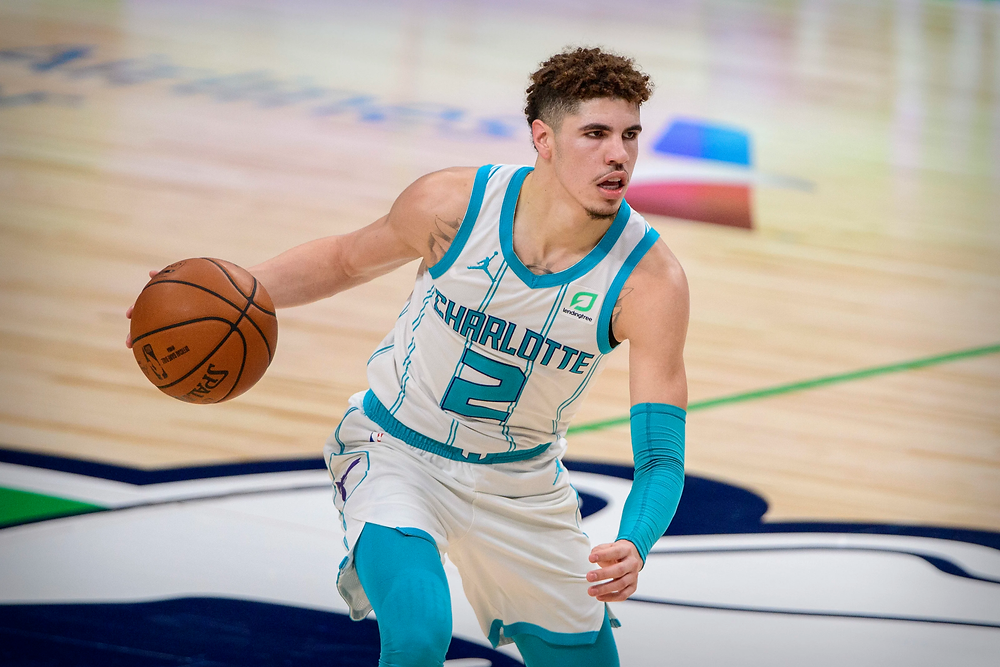 Charlotte Hornets rookie point guard LaMelo Ball prepares to pass the basketball during an NBA basketball game against the Dallas Mavericks.