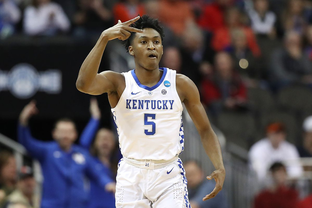 Kentucky Wildcats guard Immanuel Quickley celebrates a made 3-pointer in an NCAA basketball game.