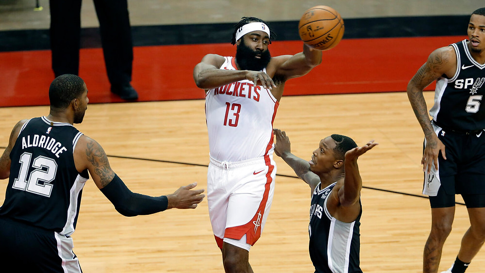 Houston Rockets shooting guard James Harden passes the ball out to the perimeter during an NBA preseason game at Toyota Center against the San Antonio Spurs on December 15, 2020.