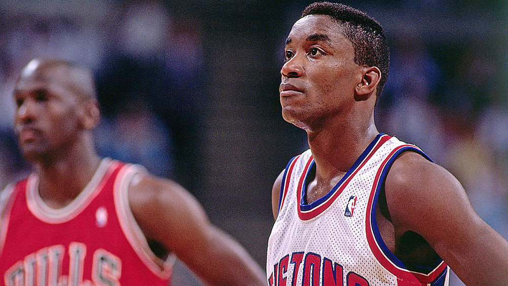 Michael Jordan and Isiah Thomas stand next to each other in an NBA basketball game.