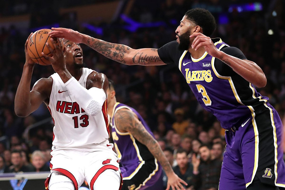 Anthony Davis of the Los Angeles Lakers blocks Bam Adebayo's shot in an NBA game.