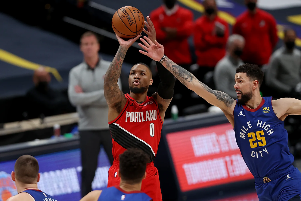 Portland Trail Blazers point guard Damian Lillard shoots a 3-pointer over Denver Nuggets guard Austin Rivers during Game 5 on Tuesday night.