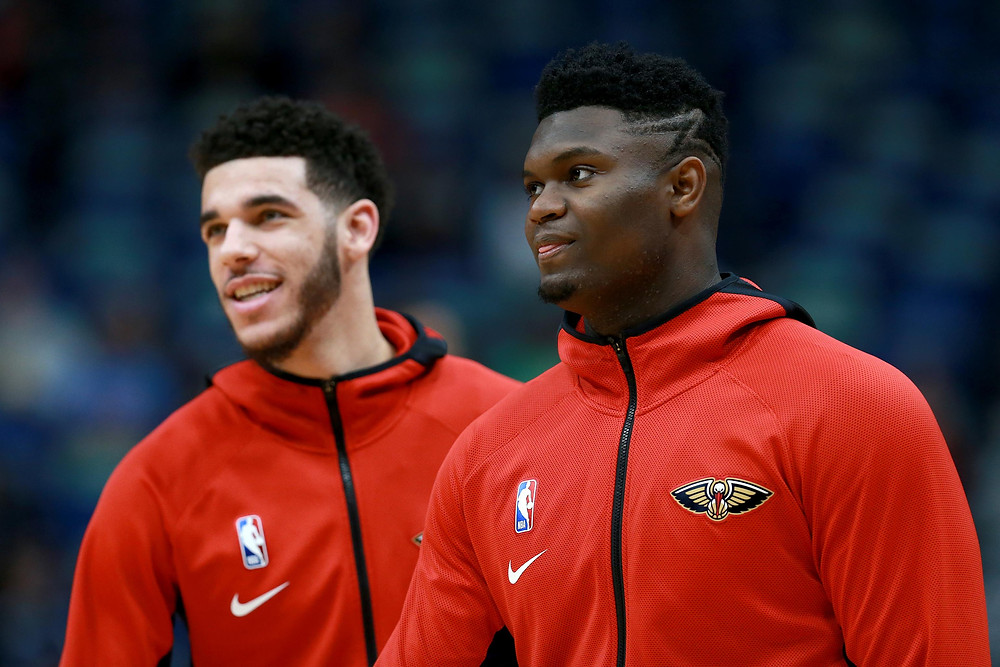 Lonzo Ball and Zion Williamson of the New Orleans Pelicans prepare to play an NBA game.