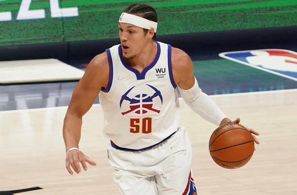 Denver Nuggets power forward Aaron Gordon dribbles the basketball on offense during an NBA basketball game.