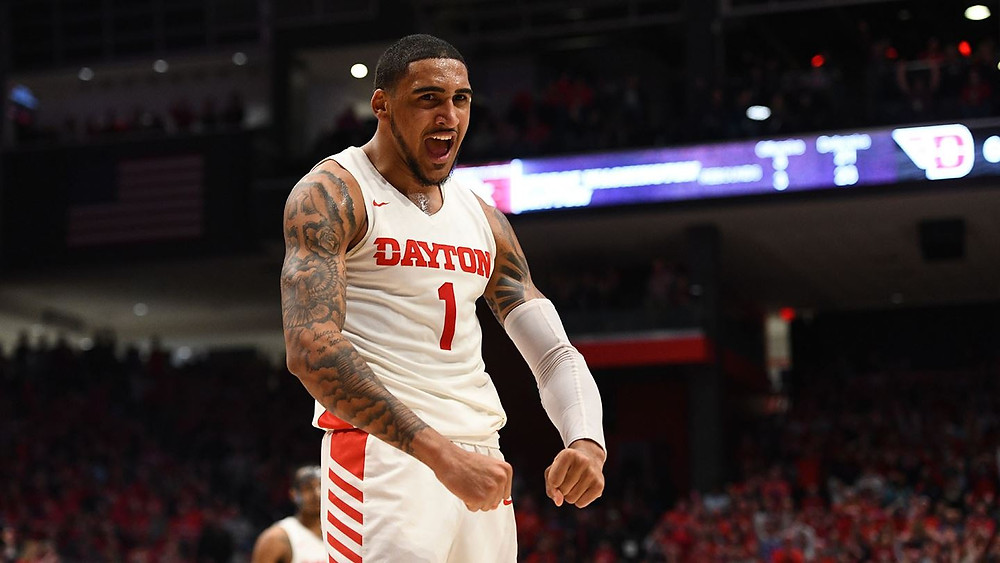 New York Knick and former Dayton Flyer Obi Toppin flexes after a made basket during an NCAA basketball game.