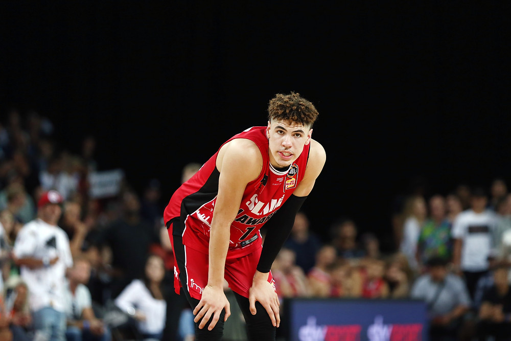 LaMelo Ball of the Illawarra Hawks rests his hands on his knees during an NBL game.