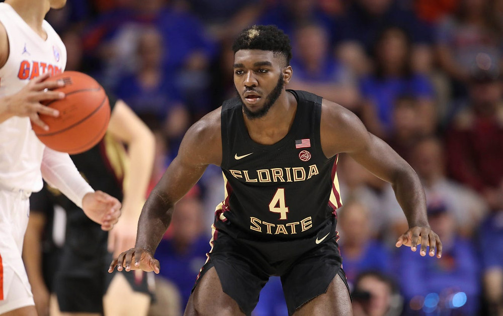 Patrick Williams of the Florida State Seminoles guards a Florida Gator.