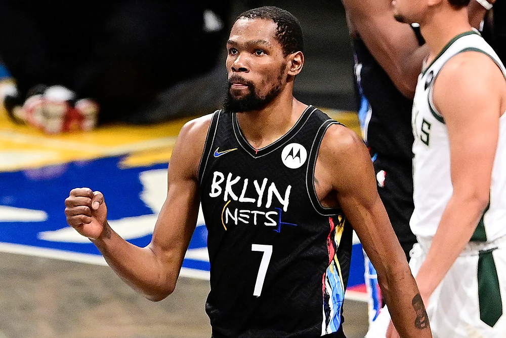 Brooklyn Nets forward Kevin Durant pumps his fist during an NBA basketball game against the San Antonio Spurs.