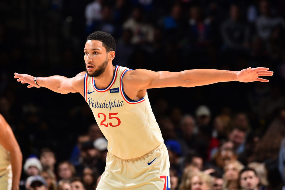 Philadelphia 76ers point guard Ben Simmons spreads his arms on defense during an NBA basketball game.