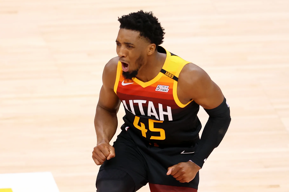 Utah Jazz guard Donovan Mitchell celebrates after being fouled on a 3-point attempt during their Game 2 matchup against the Memphis Grizzlies at Vivint Arena in Salt Lake City on Wednesday, May 26, 2021.