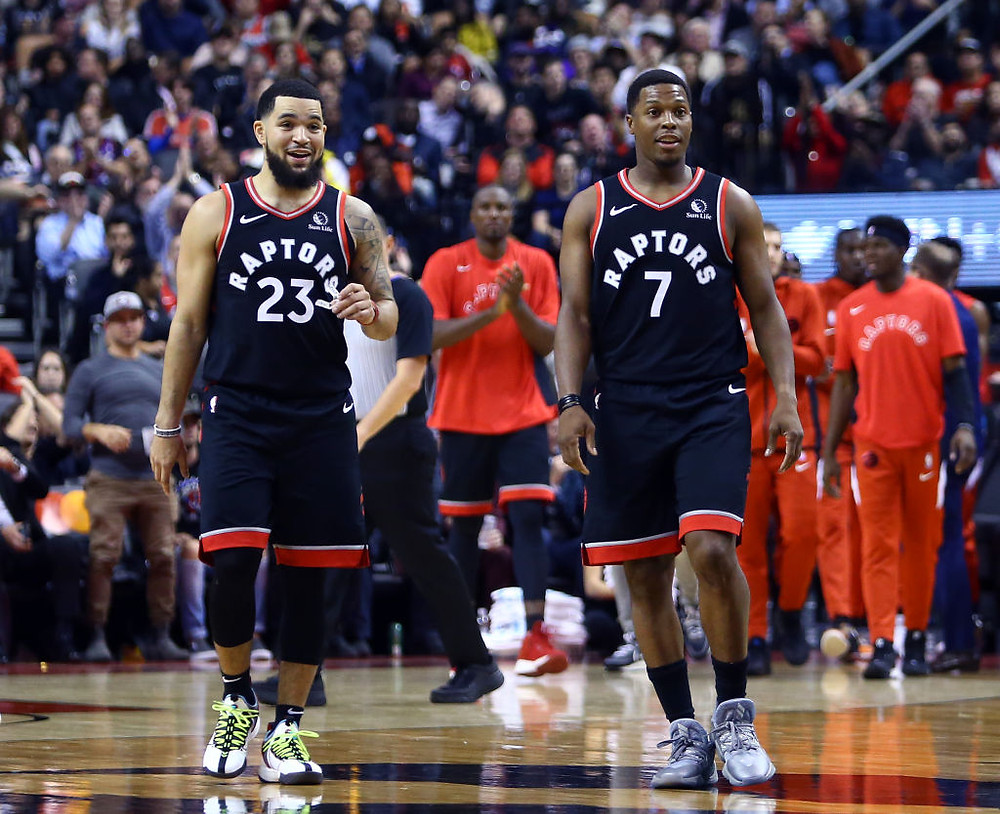 Fred VanVleet (23) and Kyle Lowry (7) of the Toronto Raptors talk during a timeout.
