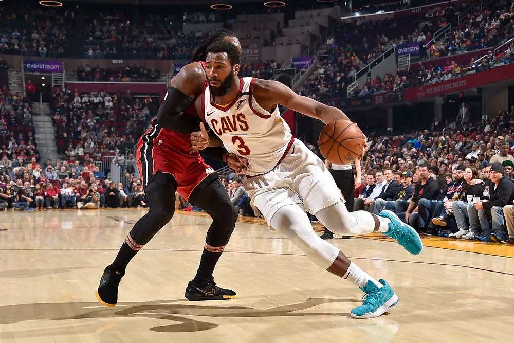 Cleveland Cavaliers center Andre Drummond drives against power forward Jae Crowder during an NBA basketball game.